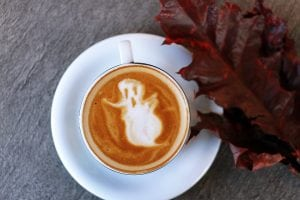 Ghost in a cup with coffee